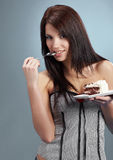 woman  eat a slice of a sweet cake Stock Photos