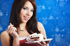 Woman  eat a slice of a sweet cake Royalty Free Stock Photography