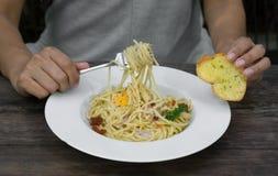 Woman eat spaghetti and garlic bread. Royalty Free Stock Photography