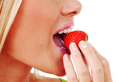 Woman eat strawberry Stock Image