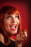 Woman eat strawberry Stock Image