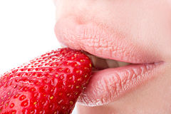Woman eat strawberry. Seductive woman with red lips eating a fresh strawberry Royalty Free Stock Photo