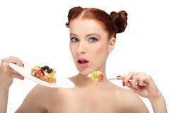 Woman eat tasty cake Stock Photos