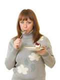 Woman eat tasty cake Royalty Free Stock Images