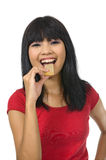 Woman Eat Wafer. Asian women eat wafer wearing red shirt isolated over white background royalty free stock images