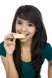 Woman Eat Wafer. Asian woman eat wafer isolated over white background stock images