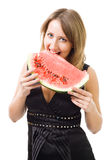 Woman eat watermelon and smiling Royalty Free Stock Photos