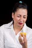 Woman eat yellow lemon Royalty Free Stock Images