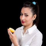 Woman eat yellow lemon Stock Images