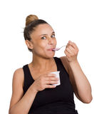 Woman eat yogurt Stock Image
