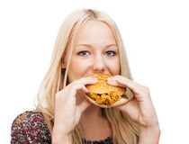 Woman eatiing burger Royalty Free Stock Photos