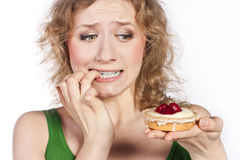 Free Woman Eating A Cake. In Studio Stock Photography - 25929732