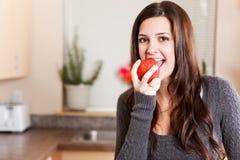 Woman eating apple royalty free stock photos