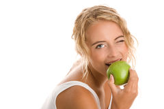 Woman eating apple. Young woman eating green apple Royalty Free Stock Images