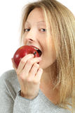 Woman eating an apple Royalty Free Stock Image