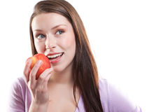 Woman eating apple Royalty Free Stock Photography