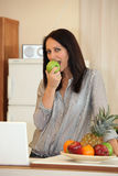 Woman eating an apple Stock Image