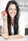 Woman eating an apple Stock Photography