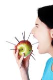 Woman eating an apple with needles, pain concept Royalty Free Stock Photos