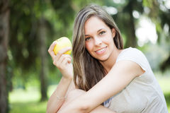 Woman eating an apple Stock Images