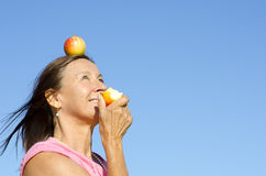 Woman eating an apple VI Royalty Free Stock Photo