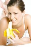Woman eating banana Royalty Free Stock Image
