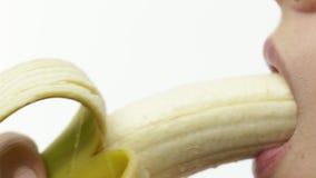 Woman Eating Banana. Passionate young woman eating banana, closeup stock video