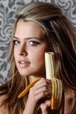 Woman eating banana Stock Photography