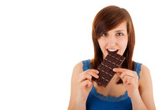 The woman is eating a bar of chocolate Royalty Free Stock Image