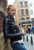 Woman eating belgian waffle on street of Brussels. Royalty Free Stock Photo