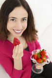 Woman eating berries Stock Images
