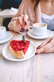 Woman eating berry dessert with a spoon in  coffee shop Stock Images