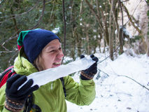 Woman eating a big icicle royalty free stock image