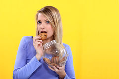 Woman eating biscuit Royalty Free Stock Image
