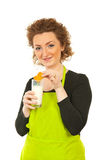 Woman eating biscuit with milk Stock Photography