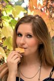 Woman eating a biscuit Stock Photo