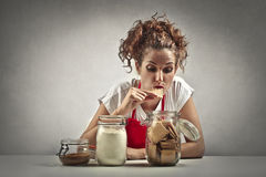 Woman eating biscuits Royalty Free Stock Photography