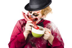 Woman eating bloody hand Stock Photo