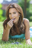 Woman Eating Blueberries Fruit Outside Royalty Free Stock Photography