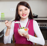 Woman eating boiled rice Royalty Free Stock Image