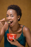 Woman eating bowl of cereal Royalty Free Stock Images