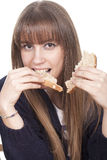 Woman eating bread Royalty Free Stock Image