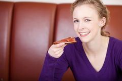 Woman eating bread and jam Stock Images