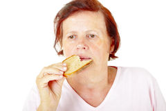 Woman eating bread Stock Photo