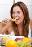 Woman eating breakfast Royalty Free Stock Photo