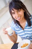 Woman eating breakfast Royalty Free Stock Image