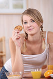 Woman eating  breakfast Stock Images