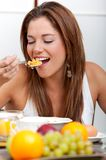 Woman eating breakfast Stock Photo