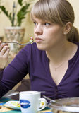 Woman eating breakfast Royalty Free Stock Images