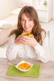 Woman Eating Breakfast At Home